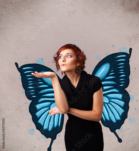 Young girl with butterfly blue illustration on the back