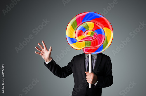 Businessman holding a lollipop