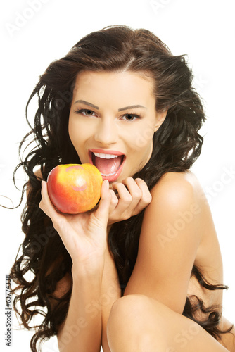 Happy nude woman with apple