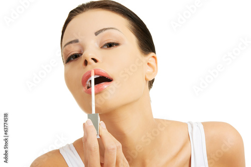 Putting on lip gloss