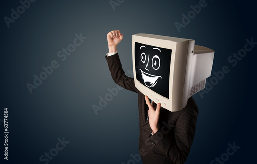 Happy businessman with a PC monitor head and a smiley face