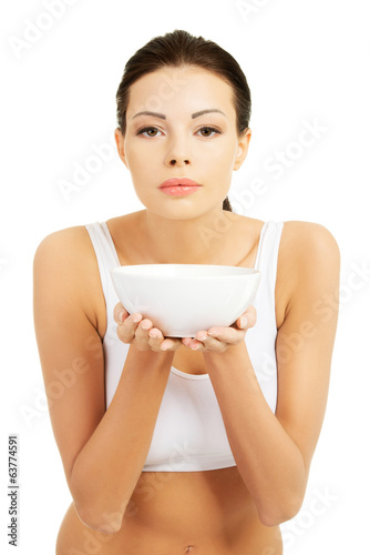 Beautiful young woman holding bowl