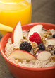 canvas print picture - Bowl of steel cut oats served with fresh fruit and honey