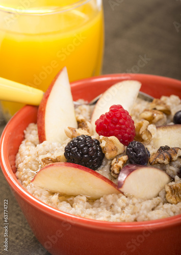canvas print picture Bowl of steel cut oats served with fresh fruit and honey