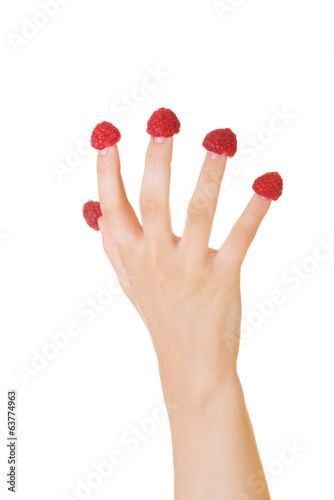 Hand with raspberries.