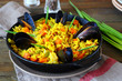 hot paella with vegetables and mussels