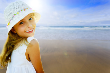 Summer vacations - cute girl on the beach
