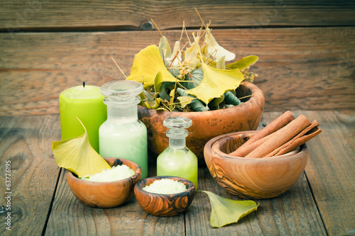 herbal salt in the wooden bowl and herb on wooden background.
