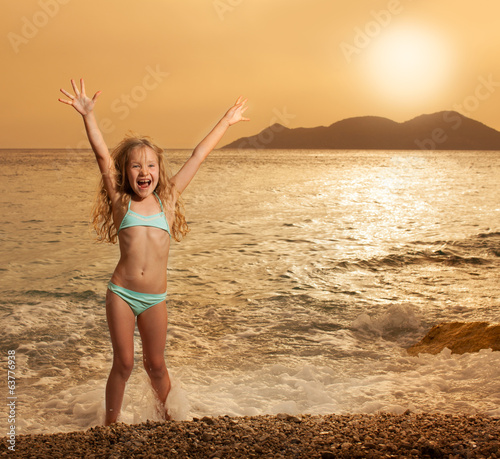 Girl on beach at sunset