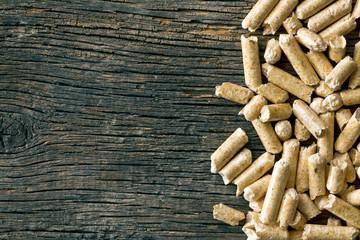 wooden pellets on old wooden background