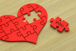 3d heart puzzle on wood