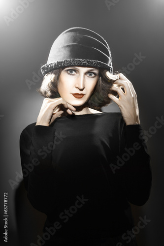 Elegant woman in hat Fashion portrait