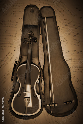 Retro violin with music sheet