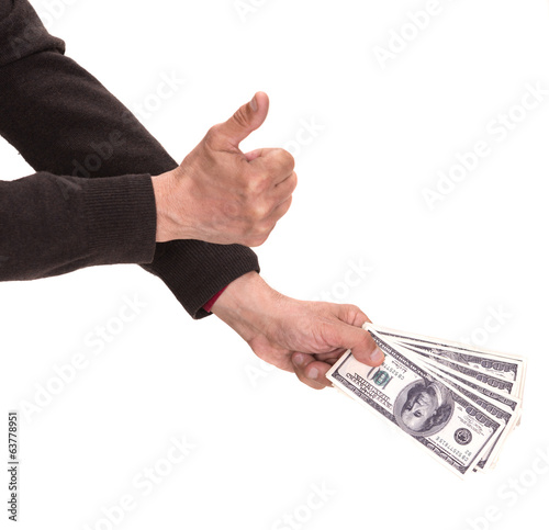 Man's hands with dollar bills showing ok sign