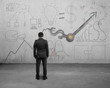 Businessman facing statistics doodles with clock hands