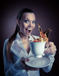 funny Woman with cup and splash of tea smile