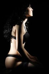 Sensual woman in lingerie on black