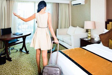 Asian woman arriving at hotel room