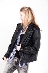 Girl in leather jacket is having fun