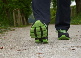 Two legs walking in spring park