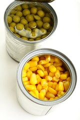green peas and corn in a can on a white background