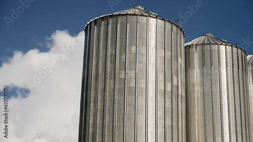 Grain Silos under Clouds time lapse footage.