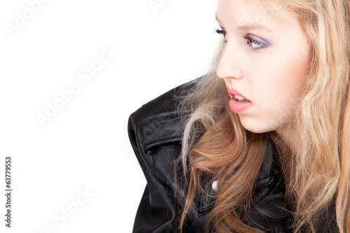 Portrait of a teenager is looking into the white