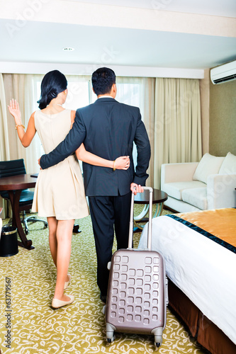 Couple arriving at hotel room