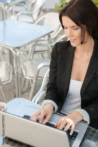 Woman laptop wifi outdoor cafe