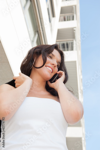 Businesswoman talking mobile phone outdoors