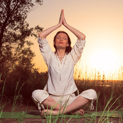 Yoga woman during sunset