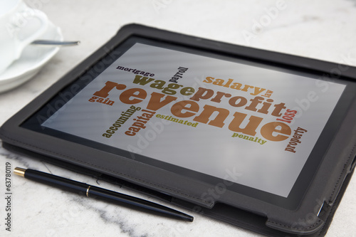 tablet with revenue tax word cloud