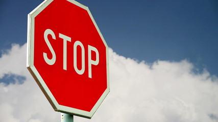 Red stop sign on the street. Roadside traffic sign for stopping