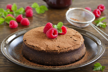Truffle chocolate cake with raspberries.