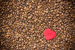 Red heart on coffee beans background