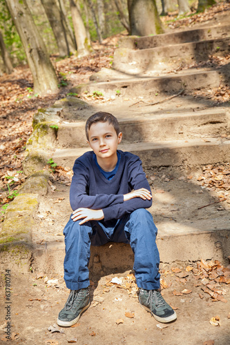 Cool confident boy in a forest