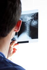 male nurse watching neck radiogram
