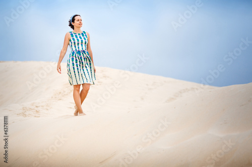 Woman on sand dune at Tarifa Andalusia in Spain