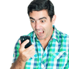 Close-up of an angry man yelling at his mobile phone