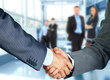 Leinwanddruck Bild - Business associates shaking hands in office