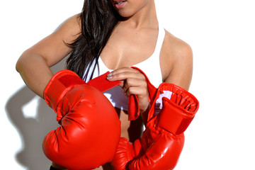 beautiful fitness woman with the red boxing gloves