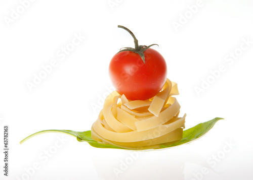 Arrangement of Tagliatelle pasta cherry tomato and basil