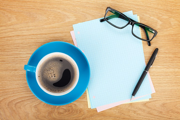 Blank lined paper with coffee, office supplies and glasses