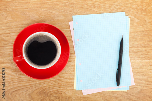 Blank lined papers with coffee cup and pen