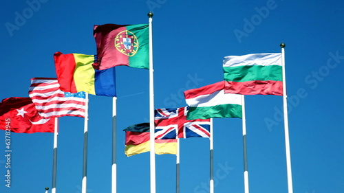 Flags of the countries of the world against the blue sky