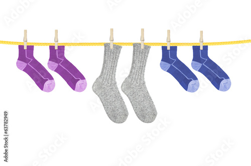 Socks hanging isolated on white