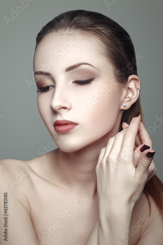 Beauty portrait of beautiful young woman with clean skin pretty
