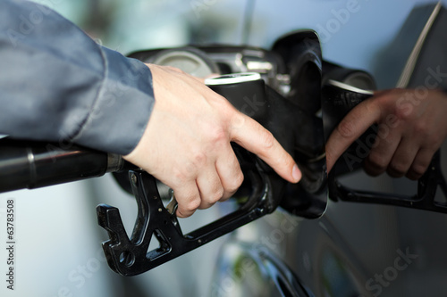 Fueling up a car at the gas station