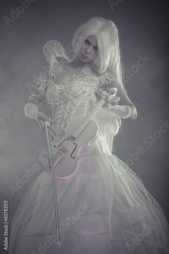 Music concept. Beautiful model with long white hair and vintage