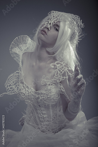 Mystic queen. Beautiful model with long white hair and vintage c